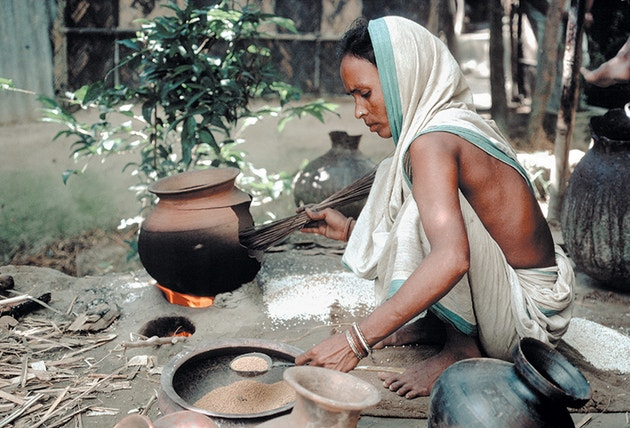 A lady pictured making food in Bangladesh